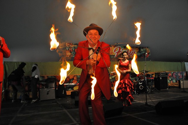 MC Ringold dazzles the main stage with his fire umbrella. Photo by Michael Ratliff.