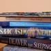 3 hardbacks, 2 paperbacks, 7 comics = $7.70