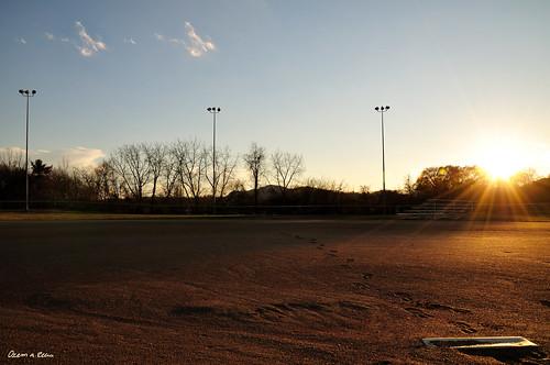 light sunset sun ny clouds photography interesting nikon footprints elite rays softball base kinston d90 kingstonpoint skytrees elitephotography