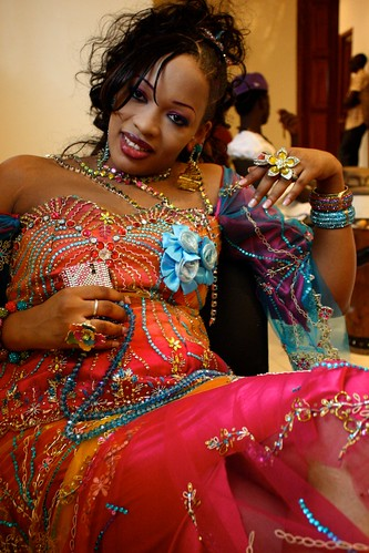 <p>Oumou Sow grabs a seat and greets old friends as she awaits her turn onstage.</p>