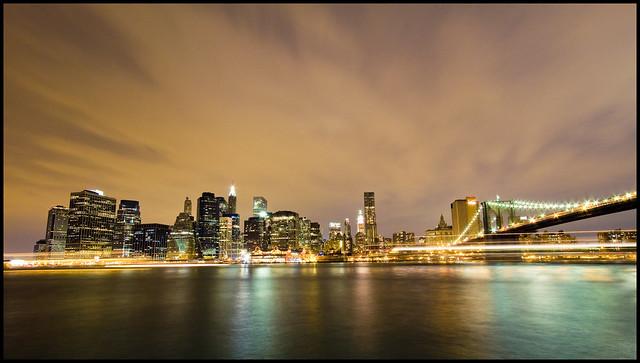 The Lower Manhattan Skyline at Night from Brooklyn Bridge Park