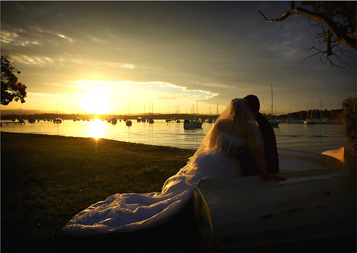 Bride and groom watching the sunset.