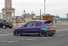 race car(0.0), family car(0.0), sedan(0.0), automobile(1.0), automotive exterior(1.0), wheel(1.0), vehicle(1.0), automotive design(1.0), peugeot 206(1.0), compact car(1.0), bumper(1.0), land vehicle(1.0), coupã©(1.0), hatchback(1.0),