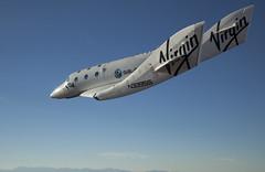 VSS Enterprise glides through the Mojave skies. Photo by Mark Greenberg