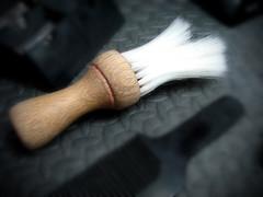 hand(0.0), arm(0.0), finger(0.0), tool(0.0), limb(0.0), leg(0.0), human body(0.0), eye(0.0), macro photography(1.0), close-up(1.0), brush(1.0), black(1.0),