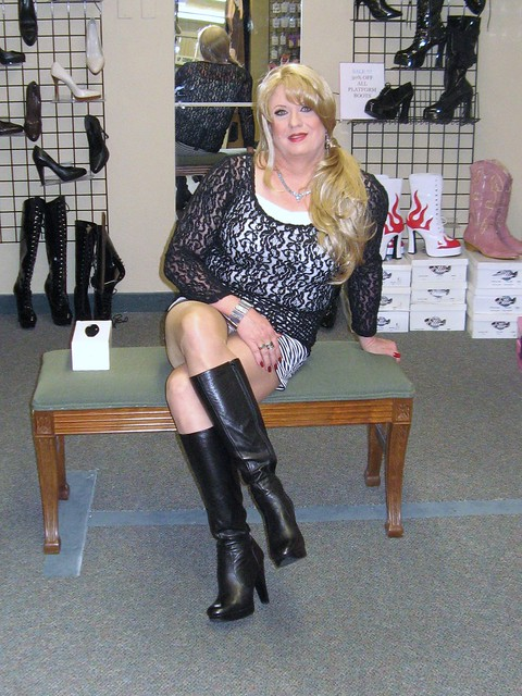 streatch mini skirt black leather boots flickr photo