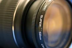 camera(0.0), wheel(0.0), single lens reflex camera(0.0), mirrorless interchangeable-lens camera(0.0), reflex camera(0.0), cameras & optics(1.0), digital camera(1.0), teleconverter(1.0), lens(1.0), fisheye lens(1.0), close-up(1.0), circle(1.0), camera lens(1.0),