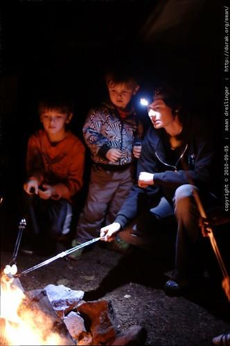 nick, sequoia & rachel roasting marshmallows on the campfire