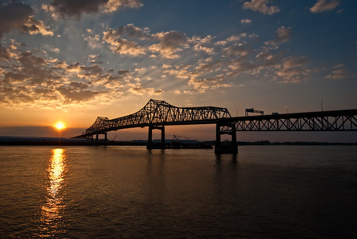 bridge sunset sun water silhouette clouds river mississippi rouge flow pier nikon louisiana downtown angle wide rays d200 nikkor current f28 baton horace wilkinson 1424mm