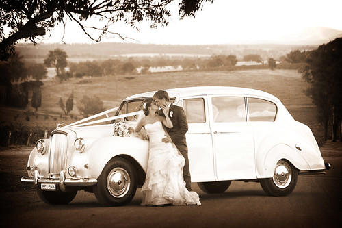 Bride and groom with a Princess car.