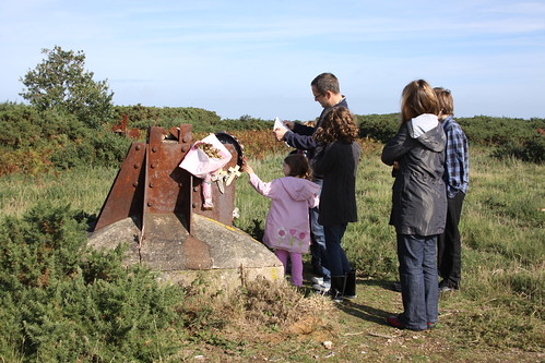 Investigating the remains of  the radar mast at Bard Hill