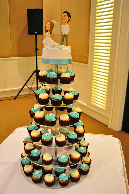 Turquoise and white wedding cupcakes White choc mud cupcakes with piped
