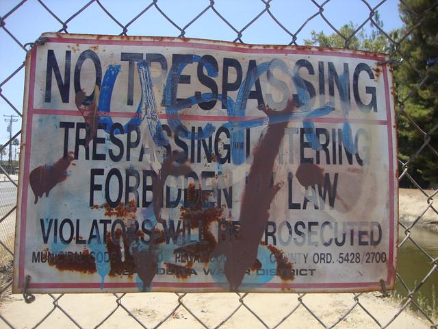 close up no trespassing painted grime