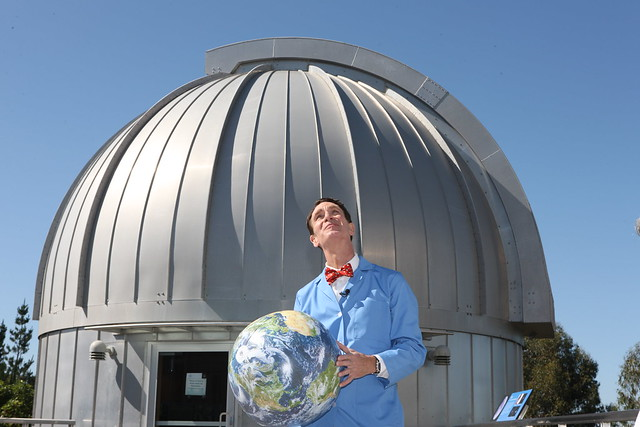 Bill Nye with Earth ball