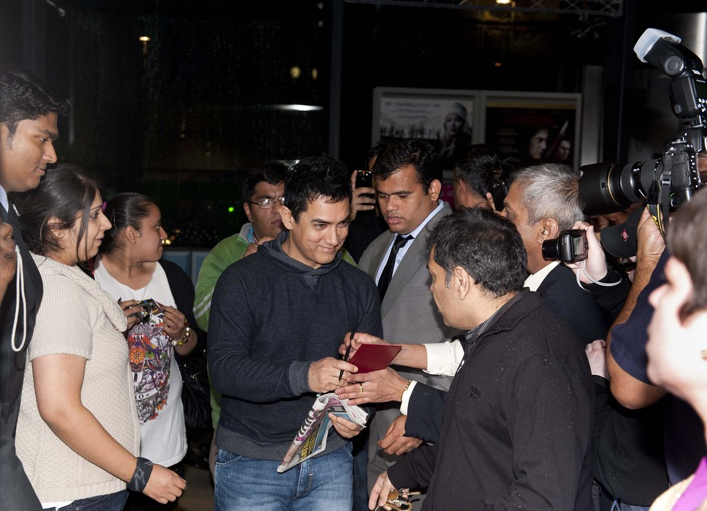 Aamir Khan greets fans before the event