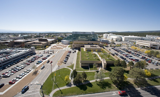 This low altitude aerial photo shows a close-up view of the LANL central technical area including the Otowi Building, the Oppenheimer Study Center, and the National Security Sciences Building (NSSB).