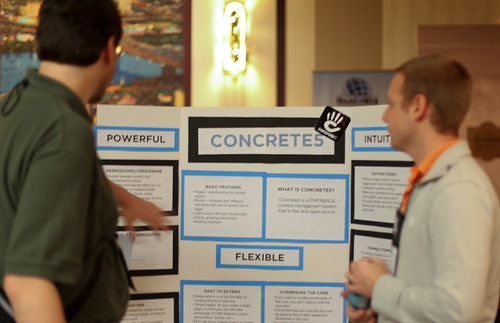 gesturing toward info on the Concrete5 poster