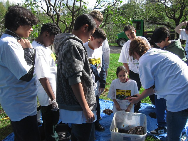 Compost project coordinator Emily Bell Dinan teaches Green Horizon students how to turn food scraps into fertile compost.