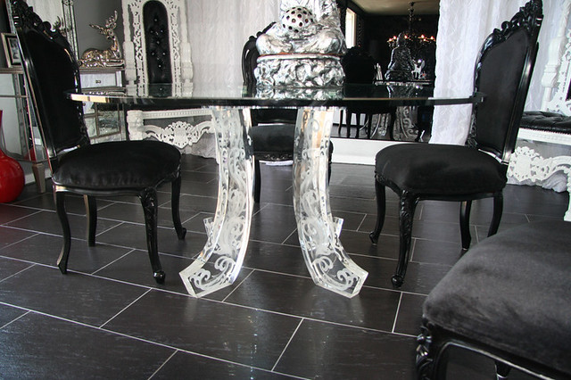 Mirrored glass dining table with black victorian chairs for Glam dining table
