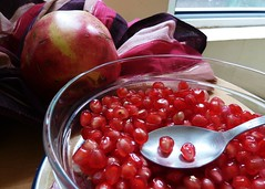 berry(0.0), plant(0.0), cranberry(0.0), pomegranate(1.0), produce(1.0), fruit(1.0), food(1.0),