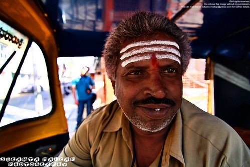 An Auto-Rickshaw Driver