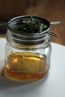 straining honey infusion