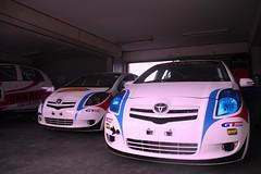 wheel(0.0), automobile(1.0), automotive exterior(1.0), toyota(1.0), vehicle(1.0), automotive design(1.0), subcompact car(1.0), toyota vitz(1.0), city car(1.0), compact car(1.0), bumper(1.0), land vehicle(1.0),