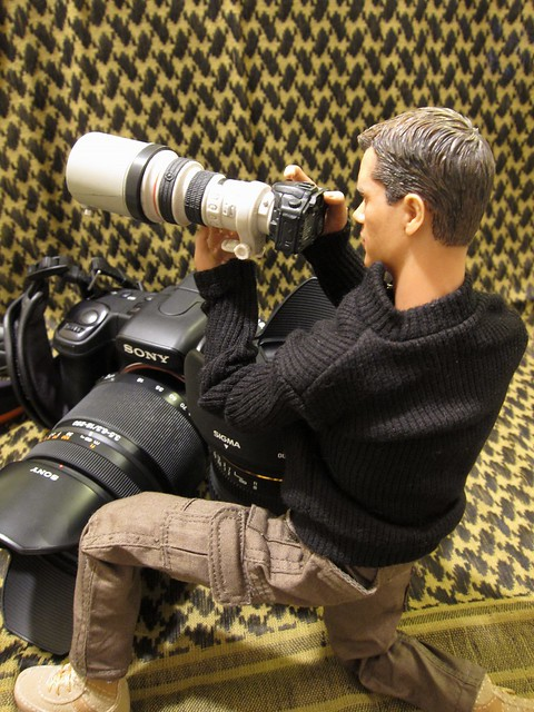 Action figure with his nice Canon DSLR set