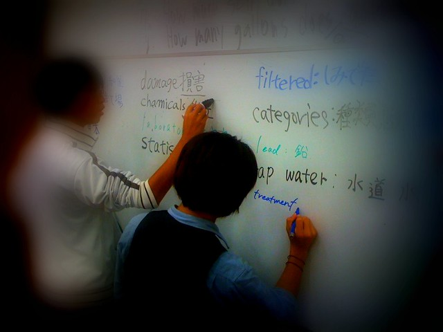SIT students writing on the whiteboard from Flickr via Wylio