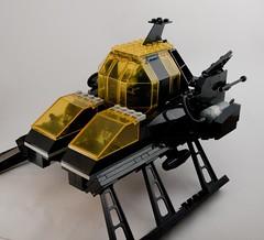 helicopter(0.0), gun turret(0.0), machine gun(0.0), military(0.0), machine(1.0), weapon(1.0), vehicle(1.0), mecha(1.0), scale model(1.0), toy(1.0),