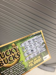 Find dollar on ground, buy lottery ticket, win $3