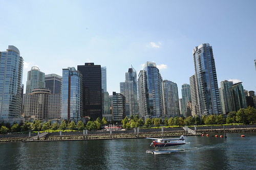 Float plane landing in Vancouver BC harbor, modern skyscrapers, cranes building, Life Release Project, Lotus Speech Canada by Wonderlane