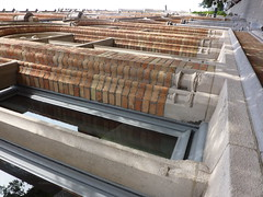 outdoor structure(0.0), reinforced concrete(0.0), baluster(0.0), roof(0.0), iron(1.0), facade(1.0), brickwork(1.0),