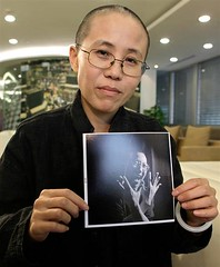 Liu Xia, wife of Liu Xiaobo, holds picture of husband taken in interview in 2009