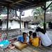 Bermain di cangkruk. : Children play in a public gathering platform. Photo by Ardian