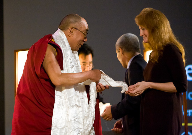 Krista Tippett Receives a Ceremonial Scarf from the Dalai Lama