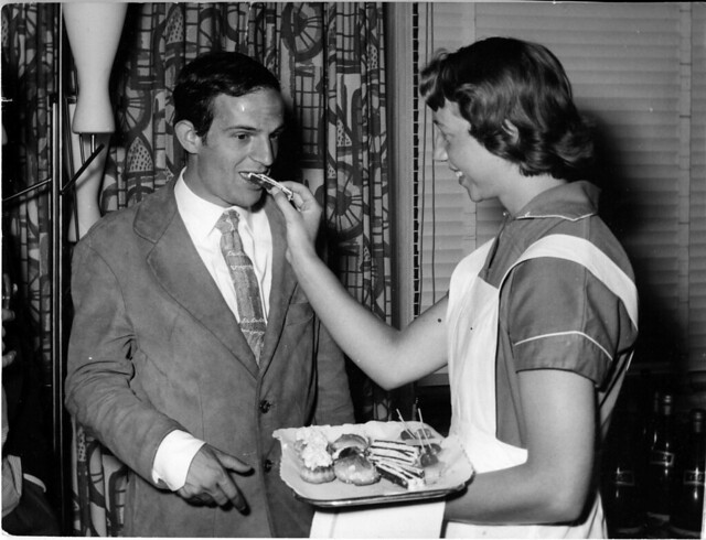 "1959 June 19 - Jo Noske, Amsterdam - François Truffaut, at cocktail party for Arnhem premiere of ""The 400 Blows,"" is given cake!"