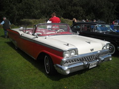 ford(0.0), ford galaxie(0.0), automobile(1.0), automotive exterior(1.0), ford fairlane 500 skyliner(1.0), vehicle(1.0), full-size car(1.0), compact car(1.0), antique car(1.0), sedan(1.0), land vehicle(1.0), luxury vehicle(1.0), convertible(1.0),
