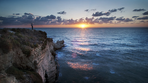 sunset lebanon sun man water clouds middleeast cliffs edge beirut mediterraneansea pigeonrocks d300s catalinmarin momentaryawecom
