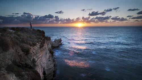 sunset lebanon sun man water clouds middleeast cliffs edge beirut mediterraneansea pigeonrocks d300s catalinmarin momentaryawecom