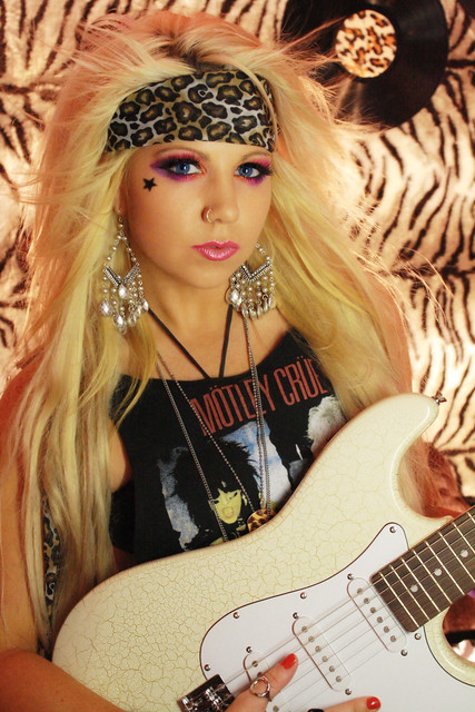 Product Features Men's Blonde 80s Glam Rock Heavy Metal Wig is a one size fits most.
