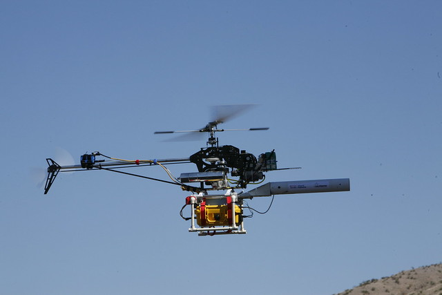 The RC helicopter with Structural Health Monitoring payload in flight during field experiments on the Alamosa Canyon Bridge near Truth or Consequences, New Mexico.  Photo by LeRoy Sanchez.