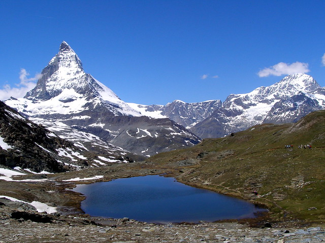 Hiking at 3000 m. high near a small  lake at  the foot of the Matterhorn Swiss