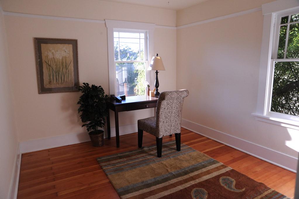 Bedroom or study, desk, chair, lamp, framed picture, carpet, hardwood floors, staged house, U District, Seattle, Washington, USA