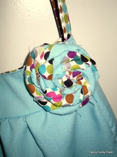 Reversible hobo bag- flower embellishment detail