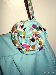 Reversible hobo bag- flower embellishment detail