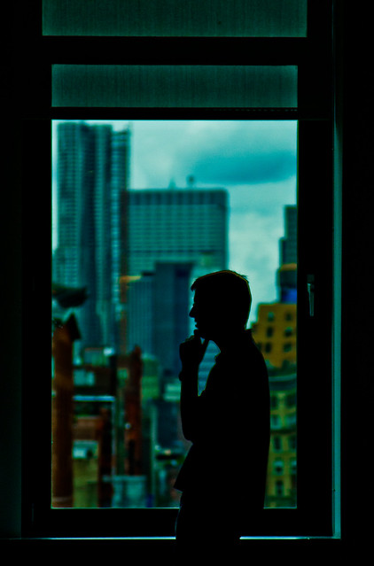Tall man in front of a window