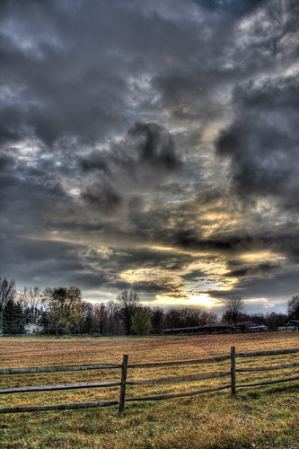 new field clouds fence dark pennsylvania wilmington