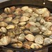 Wok full of clams