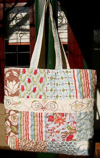 Charms and embroidered tote bag